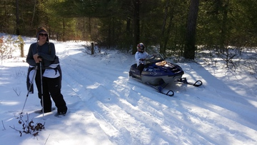 snowmobile and snowshoer in MSSF