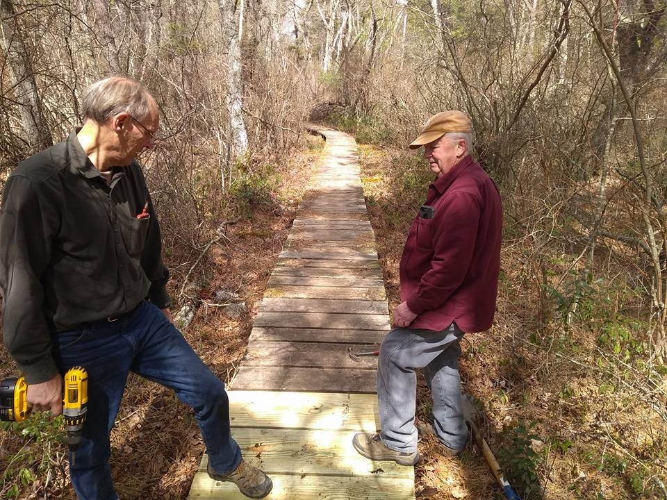 thom and roger work on boardwalk