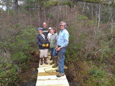 Group finishing boardwalk repairs